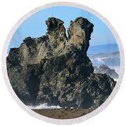 The Kissing Rocks Round Beach Towel