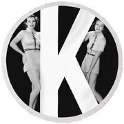 The Letter k  And Two Women Round Beach Towel