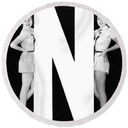The Letter n  And Two Women Round Beach Towel