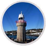 The Lighthouse And Fishing Harbour Round Beach Towel