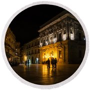 Round Beach Towel featuring the photograph The Magical Duomo Square In Ortygia Syracuse Sicily by Georgia Mizuleva