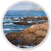The Observer - Jagged Rocks And Cliffs Of Montana De Oro State Park In California With Man Sitting Round Beach Towel