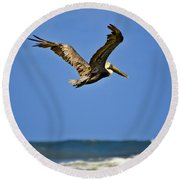 Round Beach Towel featuring the photograph The Pelican And The Sea by DigiArt Diaries by Vicky B Fuller