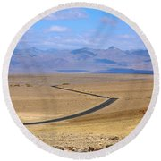 Round Beach Towel featuring the photograph The Road by Stuart Litoff