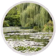 Round Beach Towel featuring the photograph The Rowboat by Victoria Harrington