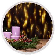 Three Candles In An Advent Flower Arrangement Round Beach Towel