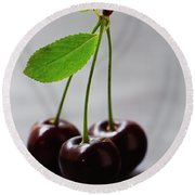 Three Cherries On A Stem Round Beach Towel