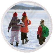 Three Kids Heading Out To Ice Skate Round Beach Towel