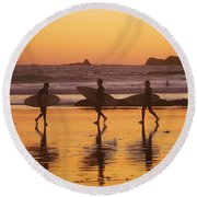 Three Surfers At Sunset Round Beach Towel