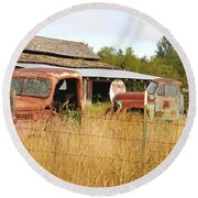To Everything There Is A Season. Rusty Old Trucks And A Barn Round Beach Towel by Connie Fox