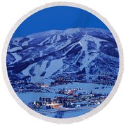 Round Beach Towel featuring the photograph Tourists At A Ski Resort, Mt Werner by Panoramic Images
