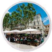 Tourists At Sidewalk Cafes, Place De Round Beach Towel