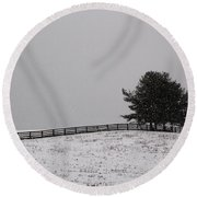 Tree And Fence In Snow Storm Round Beach Towel