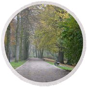 Round Beach Towel featuring the photograph Tree Lined Path In Fall Season Bruges Belgium by Imran Ahmed