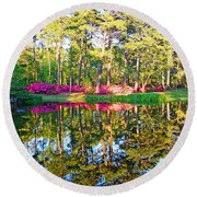 Tree Reflections And Pink Flowers By The Blue Water By Jan Marvin Studios Round Beach Towel