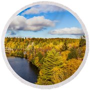 Trees In Autumn At Dead River Round Beach Towel