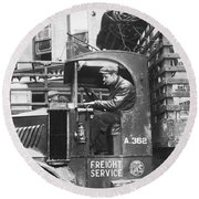 Truck Driver In His Cab Round Beach Towel by Underwood Archives