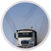 Truck Driving On Dusty Gravel Road Round Beach Towel