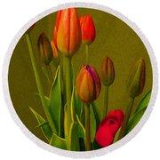 Tulips Against Green Round Beach Towel