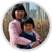 Two Chinese Teen Sisters Hug  And Embrace Shanghai China Round Beach Towel