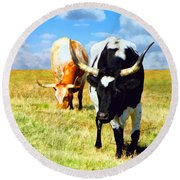Two Longhorns Grazing Round Beach Towel by Ann Powell