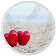 Two Red Hearts On The Beach Symbolizing Love Round Beach Towel