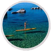 Two Women Paddle Boarding In A Lake Round Beach Towel