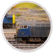 Round Beach Towel featuring the photograph Two Yellow Blue British Rail Model Railway Train Engines by Imran Ahmed