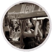 Round Beach Towel featuring the photograph Girls With Phones And Tourbus - Times Square by Miriam Danar