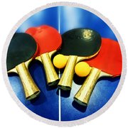 Vibrant Ping-pong Bats Table Tennis Paddles Rackets On Blue Round Beach Towel