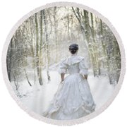 Victorian Woman Running Through A Winter Woodland With Fallen Sn Round Beach Towel by Lee Avison