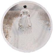 Victorian Woman Walking Through A Winter Meadow Round Beach Towel