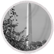 Washington Monument And Cherry Blossoms In April Round Beach Towel