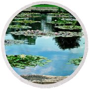 Round Beach Towel featuring the photograph Water Lily Garden by Zafer Gurel