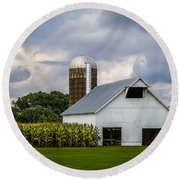 White Barn And Silo With Storm Clouds Round Beach Towel