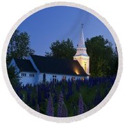 White Church At Dusk In A Field Of Lupines Round Beach Towel