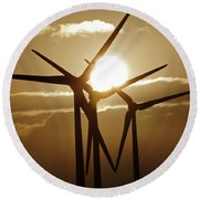 Wind Turbines Silhouette Against A Sunset Round Beach Towel
