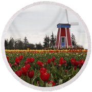 Round Beach Towel featuring the photograph Windmill Red Tulips by Athena Mckinzie