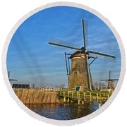 Round Beach Towel featuring the photograph Windmills And Bridge Near Kinderdijk by Frans Blok