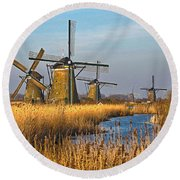 Round Beach Towel featuring the photograph Windmills And Reeds Near Kinderdijk by Frans Blok