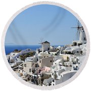 Windmills And White Houses In Oia Round Beach Towel