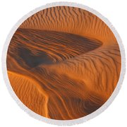 Woman In The Dunes Round Beach Towel