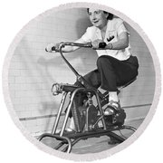 Woman On Exercycle Round Beach Towel