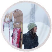 Woman Standing With Toboggan Sled Round Beach Towel