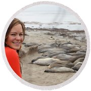 Woman With Elephant Seals In Big Sur Round Beach Towel