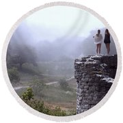 Women Overlooking Bright Foggy Valley Round Beach Towel