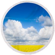Yellow Mustard Fields Under A Deep Blue Sky Round Beach Towel