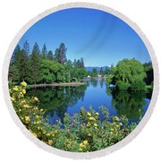 Yellow Roses By Mirror Pond Round Beach Towel