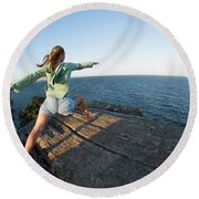 Yoga On Rocky Outcrop Above Ocean Round Beach Towel