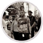 Round Beach Towel featuring the photograph Young Man And Guy With Cap - Times Square by Miriam Danar
